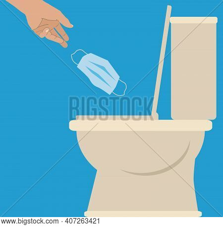 A Person Is Tossing A Face Mask Into A Toilet