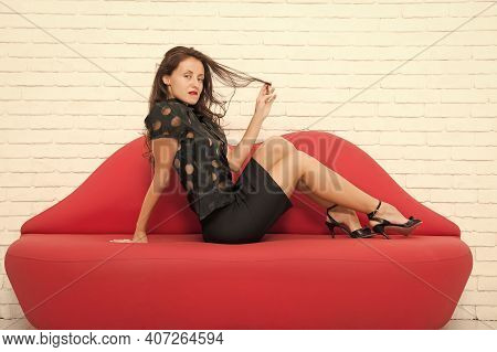 Never Enough To Be With Her. Beautiful Girl Sit On Sofa. Sexy Brunette Businesswoman. Desire And Tem