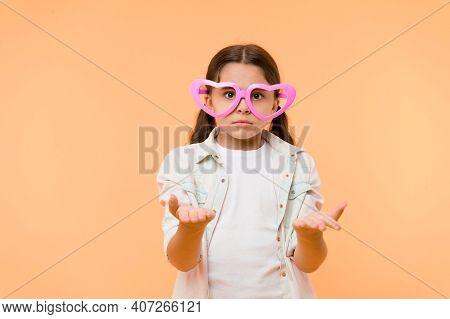 Kid Girl Heart Shaped Eyeglasses Looks Disappointed. Girl Wear Cute Eyeglasses Disappointed Face. Wh