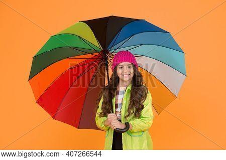 Umbrella Cant Stop Rain. Happy Small Child In Raincoat Carry Umbrella Against Rain. Cute Little Scho