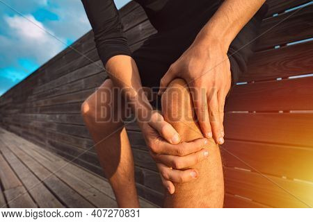 Man Holding His Painful Knee. Athlete Knee Injury And Pain. Injury From Workout