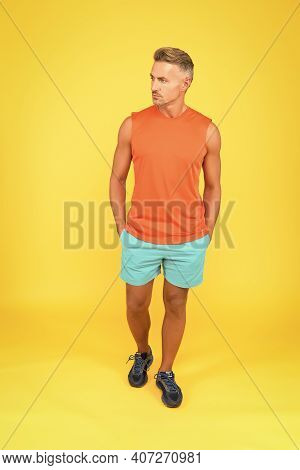 I Will Not Be Stopped. Sportsman Yellow Background. Strong Sportsman In Gym Clothes. Sportsman Physi