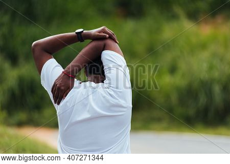 Close Up Asian Young Sport Runner Black Man Athlete Warming Up Doing Stretch Arms Before Running At