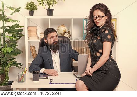 Smart And Charming. Sexy Business Lady Sit At Managers Desktop. Boss Fall In Love With Sexy Secretar