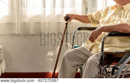 Lonely Asian Senior Man Was Sick And Sitting On Wheelchair. Retirement Age Lifestyle And Stay At Hom