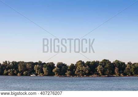 Cargo Ship, A Barge, Cruising On The Danube River In Serbia, In Belgrade, Carrying Construction Mate