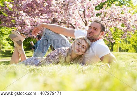 Happy Embracing Couple. Beautiful Young Family Enjoying Flowering Garden. Romantic And Love, Sensual