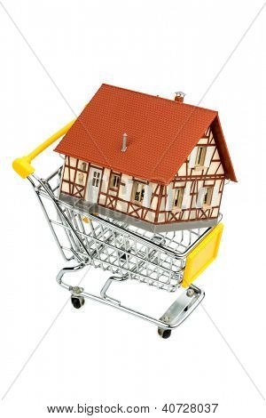 half-timbered house in the shopping cart icon photo for home purchase, financing, cost