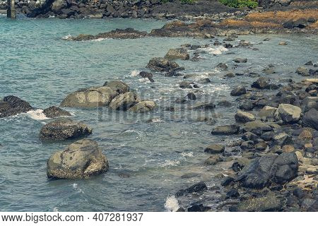 Water Over Rocks As The Tide Comes In On A Coastal Shoreline