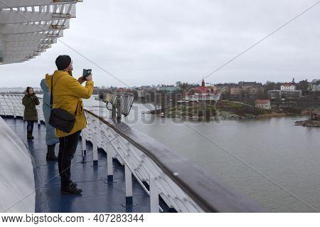 Helsinki, Finland - January 17, 2020: People Photograph Views Of Helsinki From A Passenger Ferry