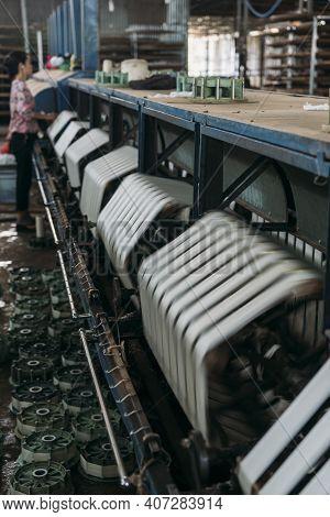 Electric Silk Factory Machines Spinning In Vietnam.