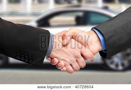 Business handshake to close the deal after buying a car poster