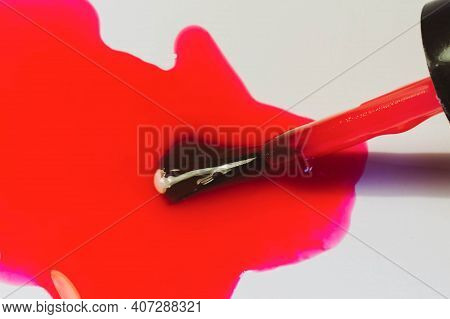 Pink, Red Nail Polish Departure From The Bottle, Brush For Applying Nail Polish On The Nails Close-u