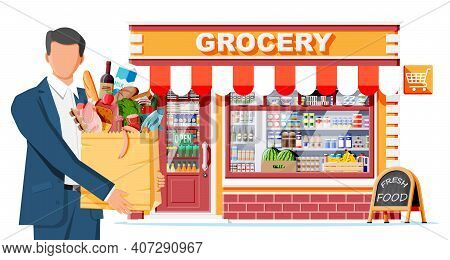 Grocery Store And Man Customer. Wooden And Brick Facade. Glass Showcase Of Boutique. Small European
