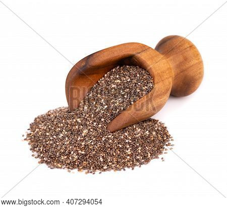 Chia Seeds In Wooden Scoop, Isolated On White Background. Healthy Superfood. Organic Chia Seeds.
