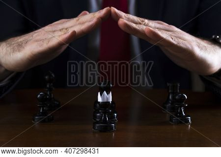The Concept Of Strategy And Business Planning, A Businessman At A Chessboard In Front Of Lined Black