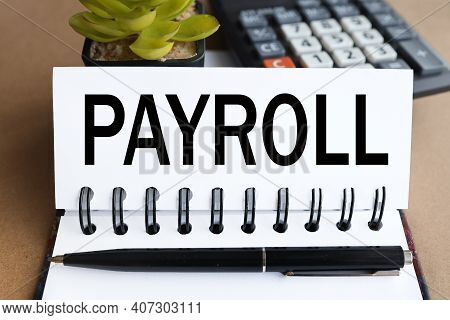 Payroll. Text On White Paper On The Background Of A Calculator