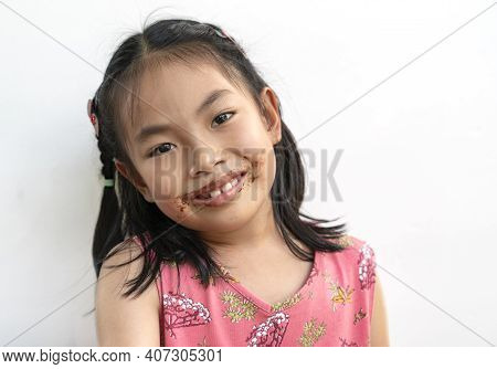 Portrait Beautiful Child Girl With Chocolate Around Her Mouth, Big Smile On Cute Face, Black Hair, W