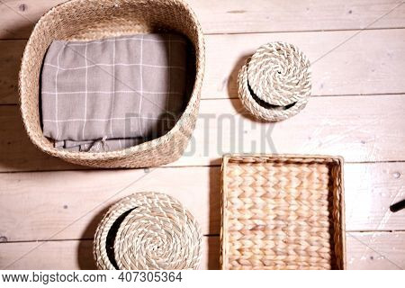 Straw Wicker Basket And White Natural Cotton Fabric. Marie Kondo's Storage Boxes, Containers And Bas