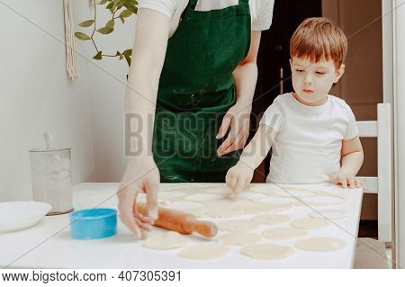 Little Boy Helps Mother To Cook  Making Homemade Coockies. Casual Lifestyle In Home Interior, Pretty