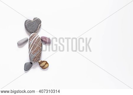 Man From Sea Pebbles On A White Background, Natural Colors And Texture Of A Stone, Eco Style, Childr