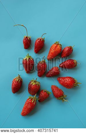 Fresh Strawberries Lie On A Blue Table Surface. Summer Season. Cover.