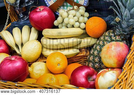 A Variety Of Tropical Fruits In A Travel Basket. Harvest Of Ripe Fruit. Concept Of A Healthy Lifesty