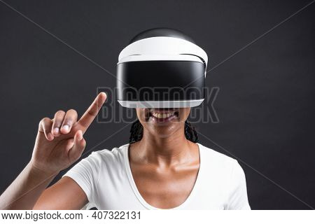 African American woman playing a virtual video game on virtual screen