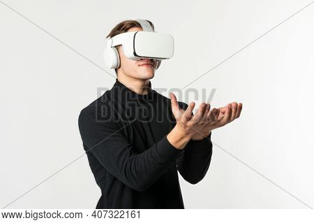 Man with VR headset touching invisible object smart technology