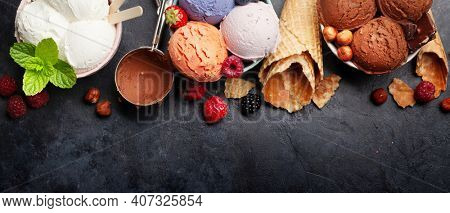 Berry, vanilla and chocolate ice cream scoops. Top view flat lay