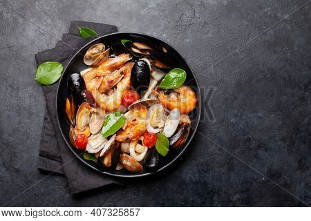 Mixed grilled seafood. Various roasted shrimps, mussels and shellfish. Top view flat lay with copy space