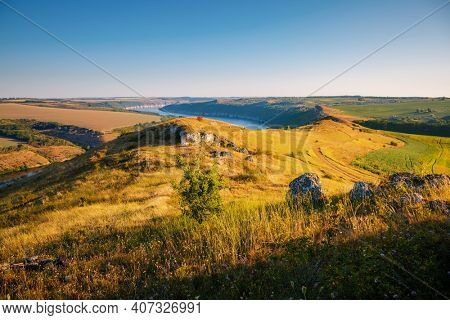Fascinating summer scene of a green hills on a sunny day. Location place Dniester canyon of Ukraine, Europe. Image of world landmarks. Picturesque photo wallpaper. Discover the beauty of earth.