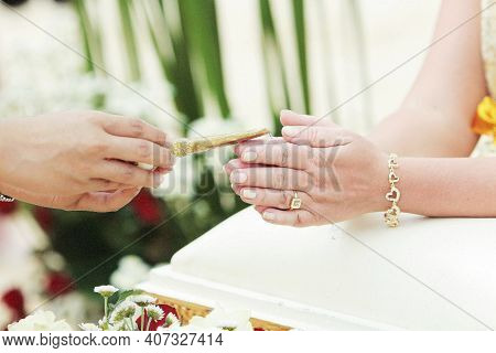 Water Being Poured On Hands Of The Bride During A Traditional Thai Wedding Ceremony. Hands Pouring B