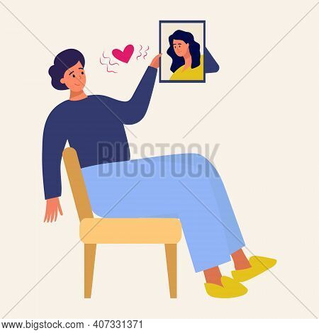 A Man Looks At A Picture Of His Beloved. A Man In Love, Love At A Distance, Framed Portrait Of His B