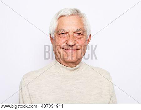 Close up portrait of happy senior man