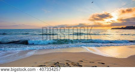 Summer Vacation At The Seaside. Beautiful Seascape At Sunrise. Calm Waves Wash The Golden Sandy Beac
