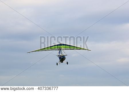 Ultralight Airplane After Take Off In A Blue Sky
