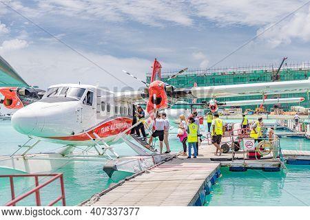 Male, Maldives - October.15.2019: Seaplane Terminal. In Maldives Islands. People Are Boarding Into D