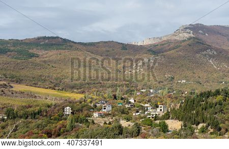 Gorgeous View Of The High Green Mountains With Houses