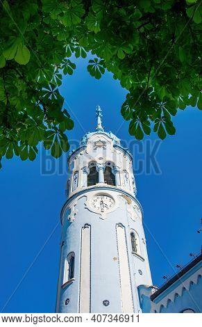 Bell Tower Of Romantic Blue Church In Bratislava, Slovakia. Hungarian Secessionist Catholic Church O
