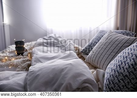 Comfortable Bed With Cushions In Room. Interior Design