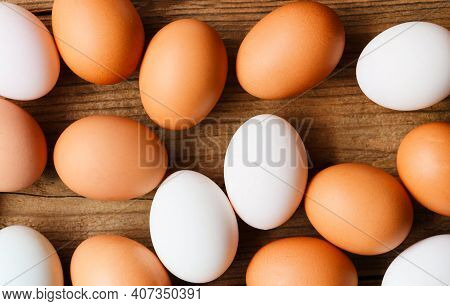 Fresh Chicken Eggs And Duck Eggs On Wooden Background Top View, Collect From Farm Products Natural I