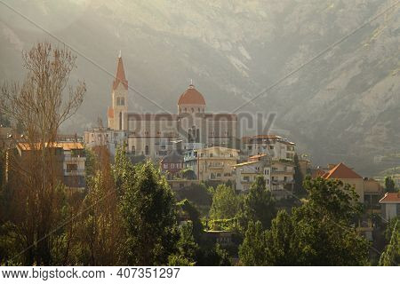 Saint Saba Church In The Lebanese Town Of Bcharre Surrounded With Trees.