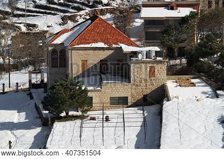 A Traditional Lebanese House Wih Its Garden Under Snow.
