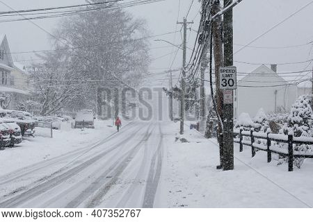 NORWALK, CT, USA -FEBRUARY 7, 2021:  Person is walking in snow storm  day on North Taylor Avein Norwalk