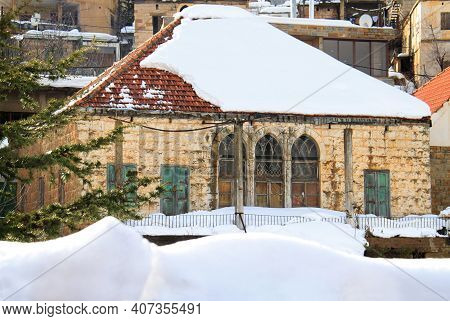 A Snow-covered Traditional Lebanese House In A Mountain Village.