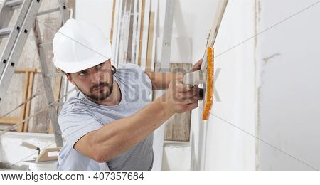 Construction Worker Are Using Sponge And Plastering Trowel To Smooth The Walls. Home Improvement, Ha