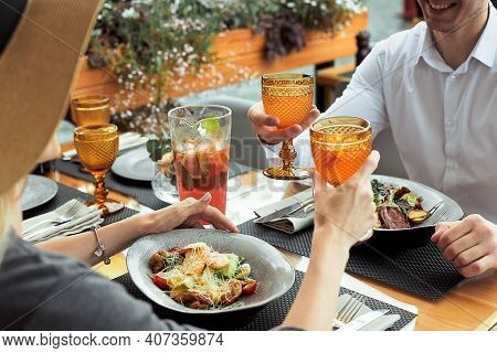 Couple Having Amazing Lunch At Outdoor Restaurant