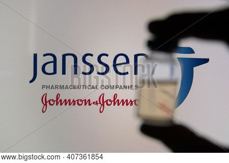 Oxford, Uk - February 2020: A Covid Vaccine Vial Against The Janssen Logo