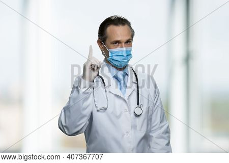 Doctors Warning You Pointing Finger Up. Please Notice Prescription. Standing In A Bright Room.